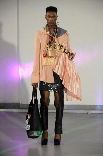 Model wears student designs at fashion runway