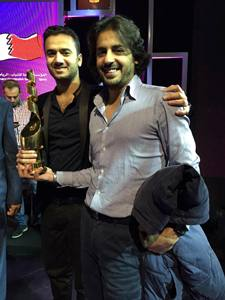 Omran and Aziz with their trophy at the NBH Awards