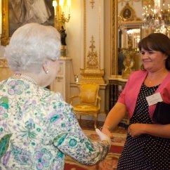 Alumna Julie Richings receiving an award from The Queen