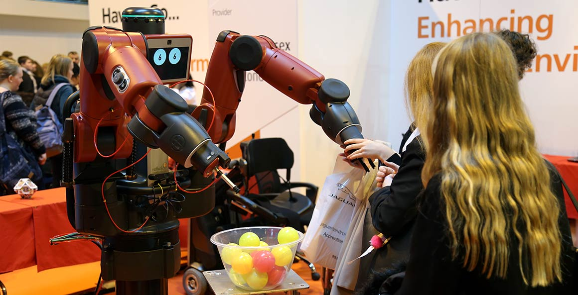 Visitors interact with Bertie the hugging robot