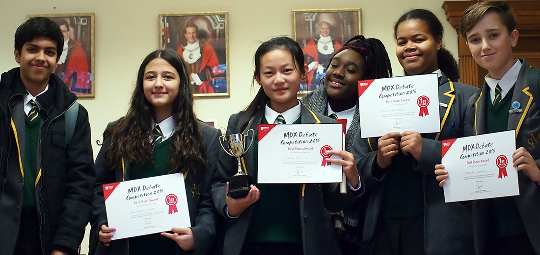 Students from St Mary's and St John's School with their winning certificates