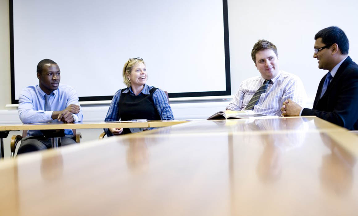 Corporate meeting in company boardroom
