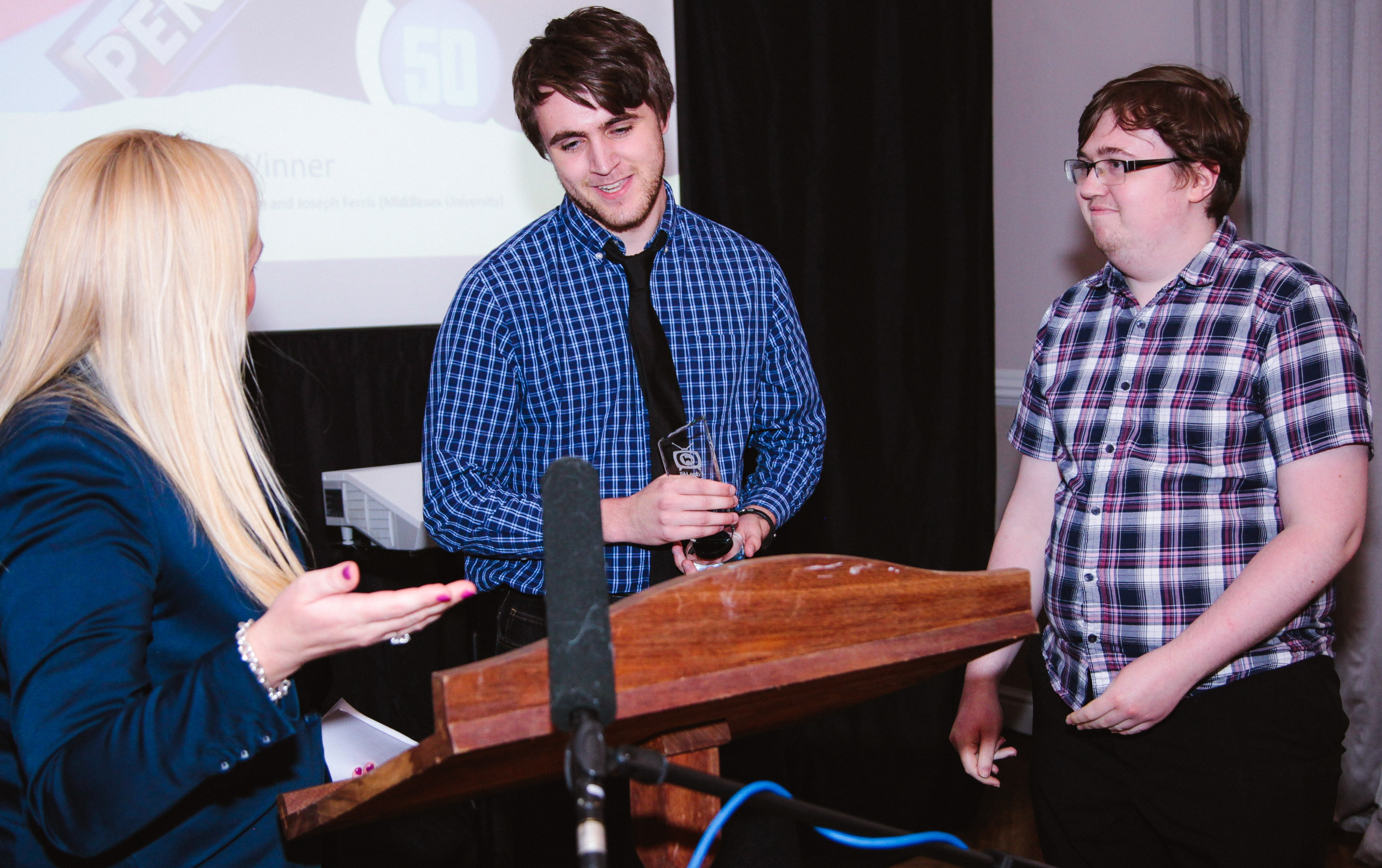 Isaac Pimm and Joseph Ferris receiving prize at Critical Awards in TV