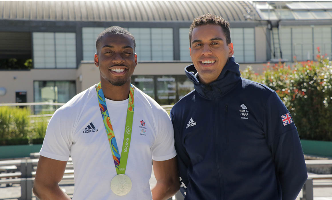 Lutalo Muhammad and James-Andrew Davis in Olympic tracksuits at Middlesex