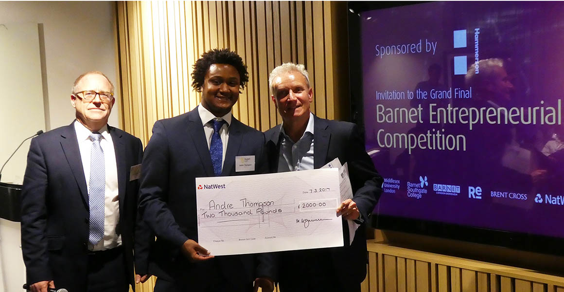 Andre Thompson receiving his cheque at the Barnet Entrepreneurial Competition final