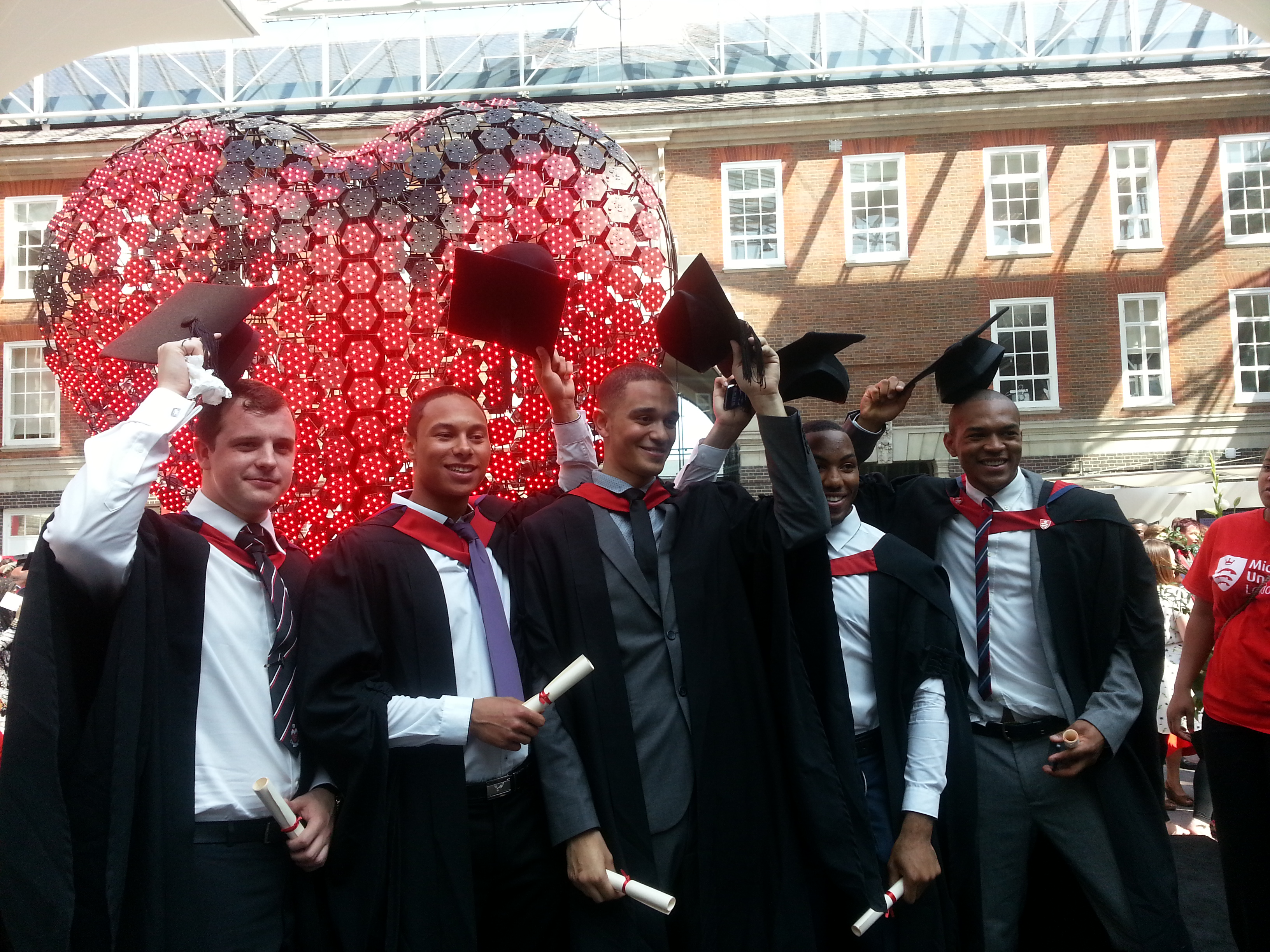 Tyle Lowe with friends at graduation