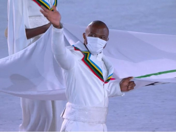 Cyrille with flag.jpg