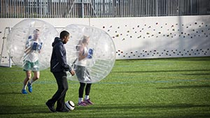 Students in football bollons