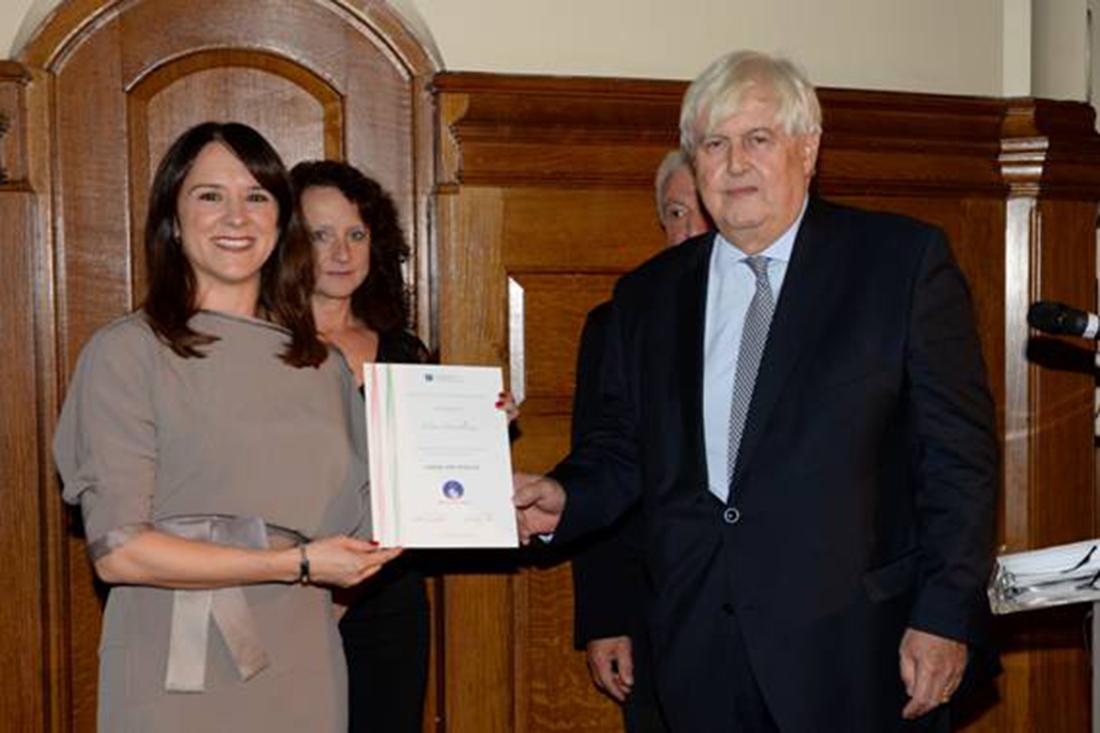 Elena receiving her award