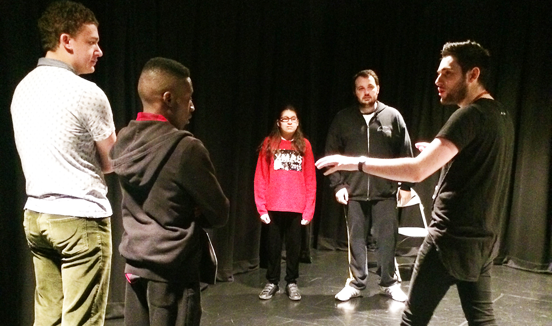 BA Theatre Arts student at a workshop with local students