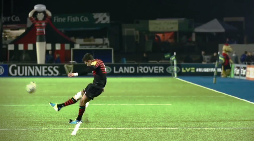 A Saracens Rugby player kicking a ball at Allianz Park
