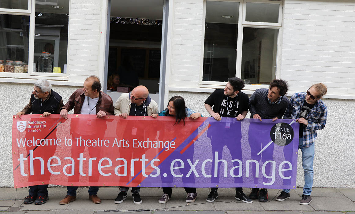 Theatre Arts Exchange students and staff holding banner