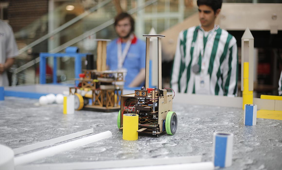 A Middlesex robot moving an object in the Eurobot final on campus