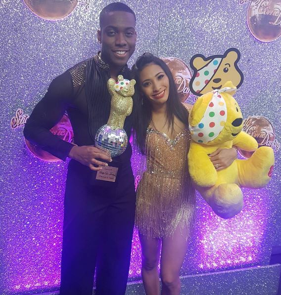 Lutalo Muhammad with his partner Karen Clifton and the Children in Need Strictly trophy