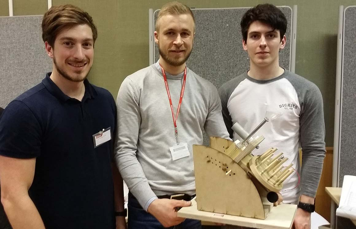 First year students with their winning design at the IMechE Design Challenge regional final
