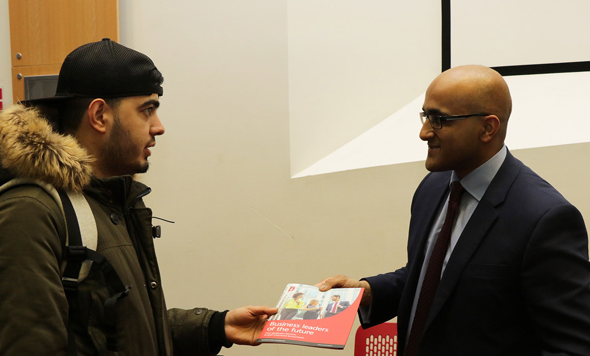 Faisal Khan, Senior Manager at ICAEW, talking to a student at Meet the Professions