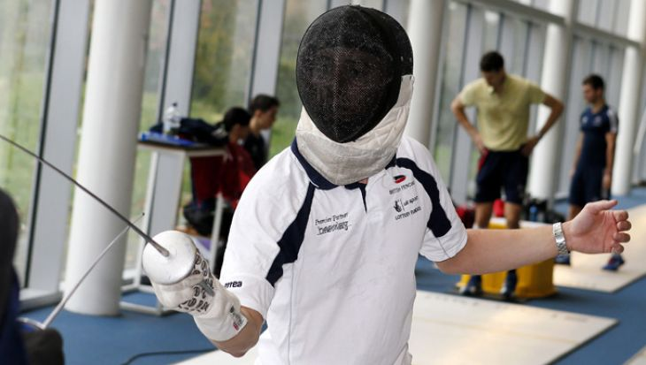 Student practising fencing moves