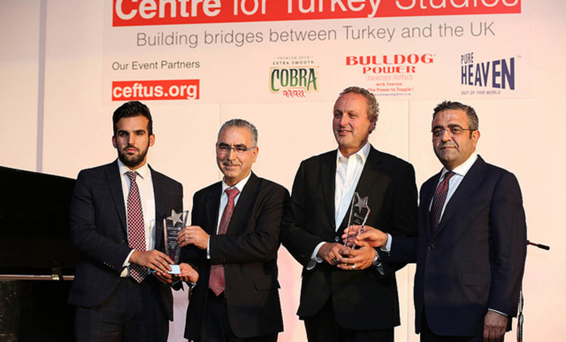 Dr Tunc Aybak with his award and the other winners