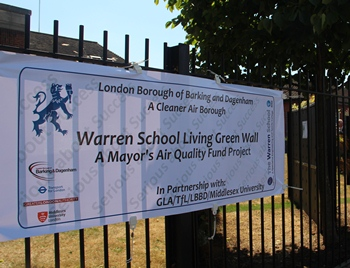 A banner explaining the green wall at Warren School.