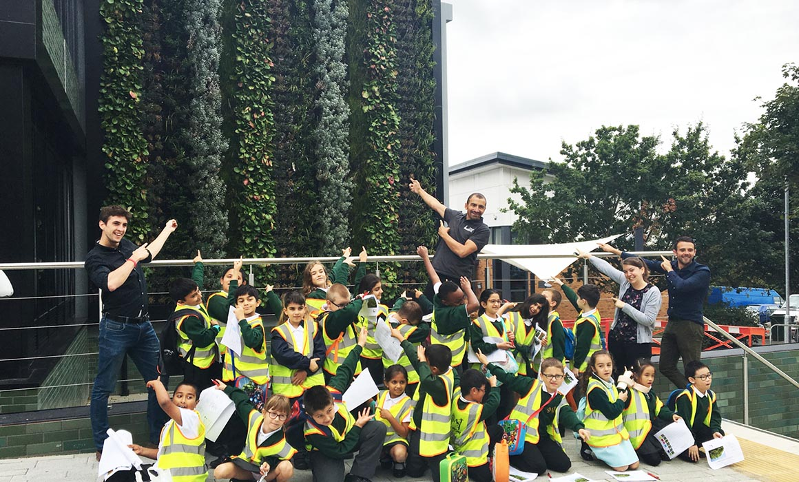 Children from Sunnyfields in front of the Living Wall