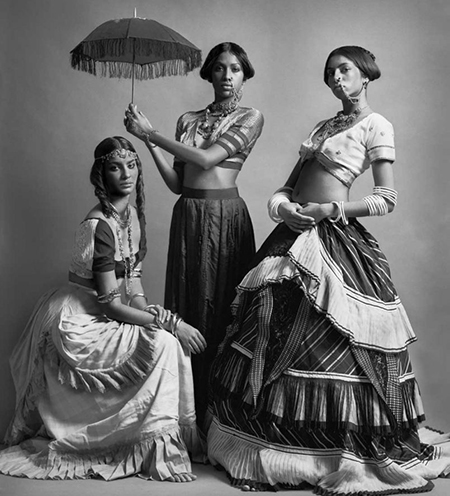 Photography of three women dressed in a mixture of modern and 20th century clothing