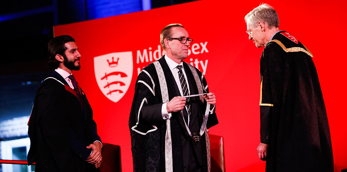 Vice-Chancellor Professor Tim Blackman is presented with a special medal during his inauguration ceremony