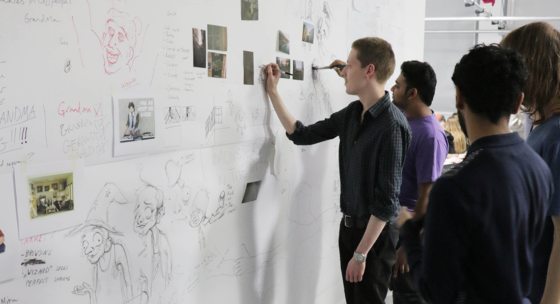 Middlesex animation students working on a storyboard together
