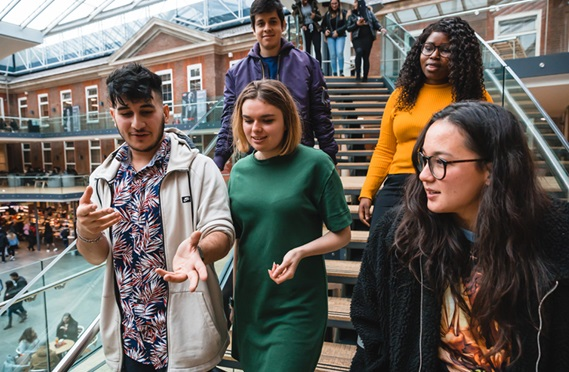 Students walking down the stairs of Quad building at Middlesex University London