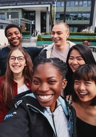 Smiling students taking selfie