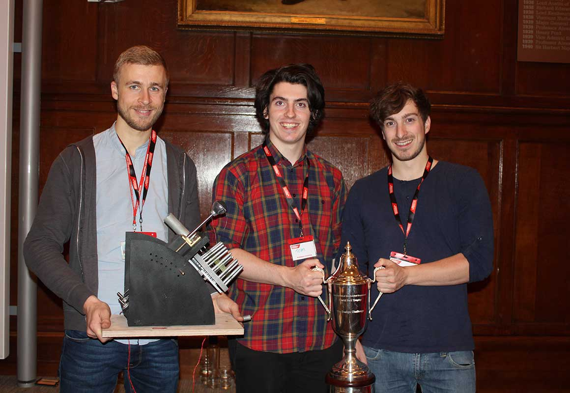 The students with their device and the National Design Challenge trophy