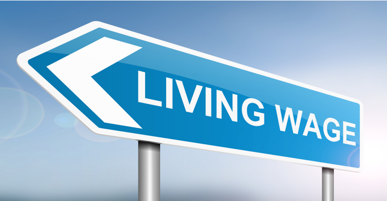 A motorway-style sign pointing left that reads Living Wage