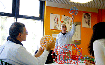 George Hart shows maths students a geometric Zome Tools sculpture