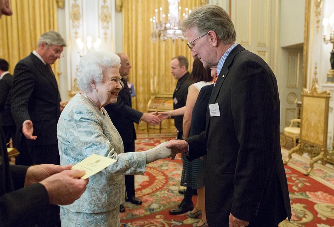 Queen Elizabeth II congratulating Dr Shayne Baker