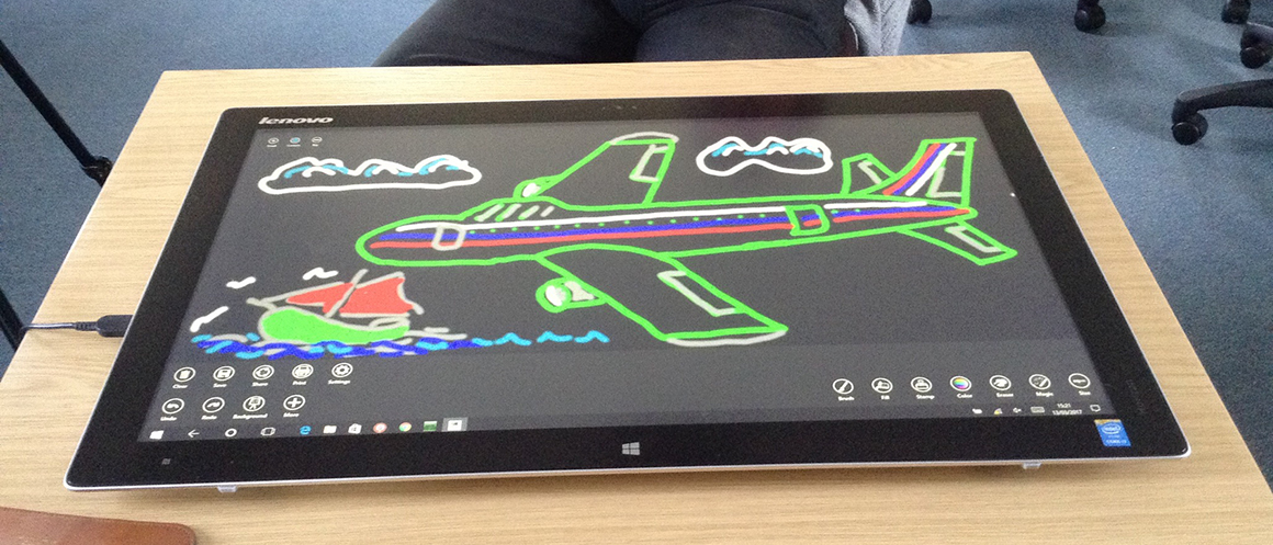 Image of a plane drawn on large tablet