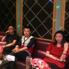 Guests at the Beijing reunion singing karaoke