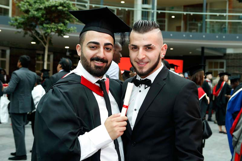 Students celebrate on the first day of graduation