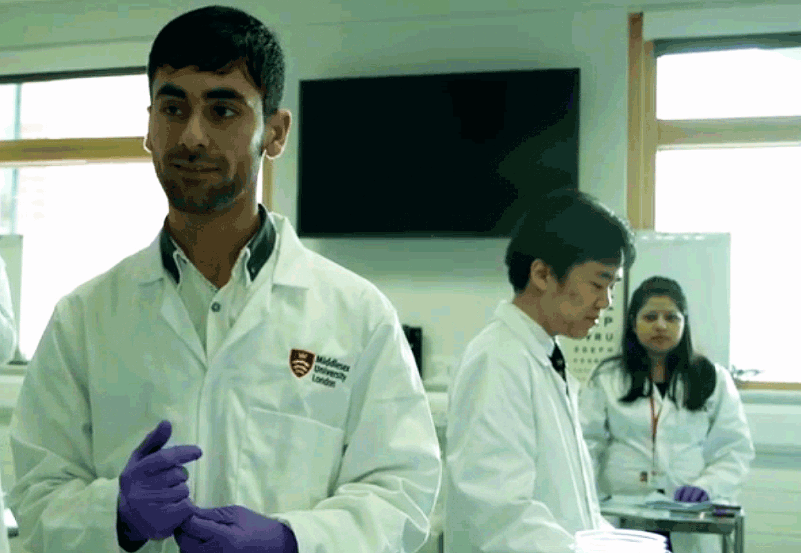 Three Biomedical Science students carry out a clinical trial in the University's laboratories