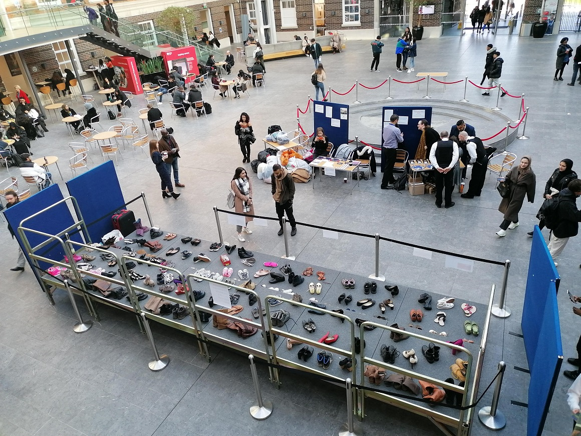 Gender violence victims remembered by powerful display featuring 111 shoes at MDX