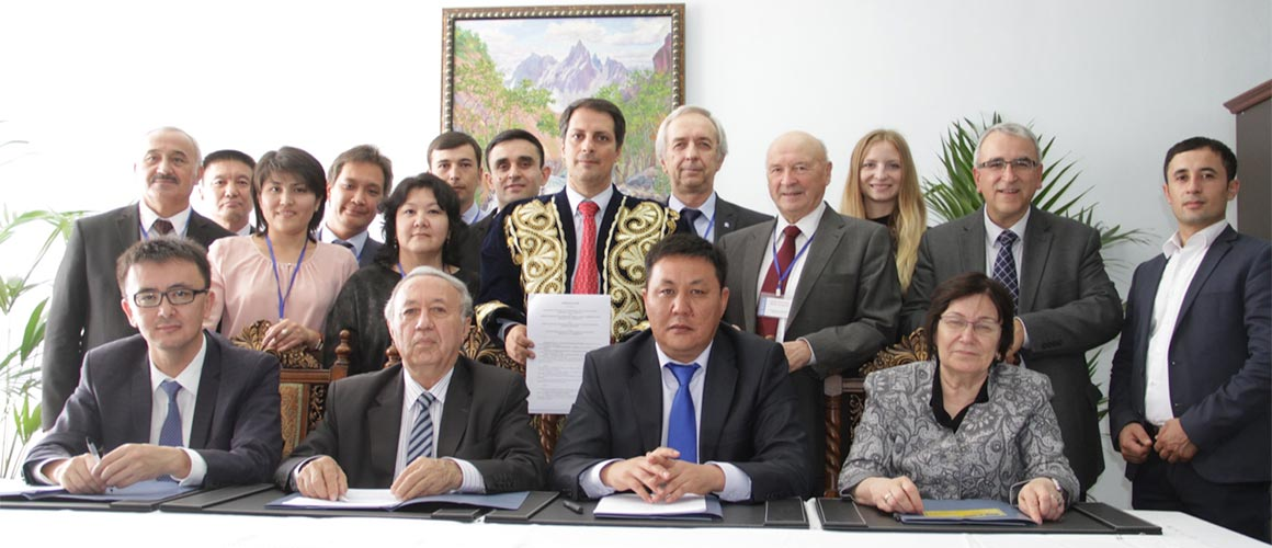 Signatories and witnesses to the Khujand Accord pose for a photograph after the historic agreement was reached
